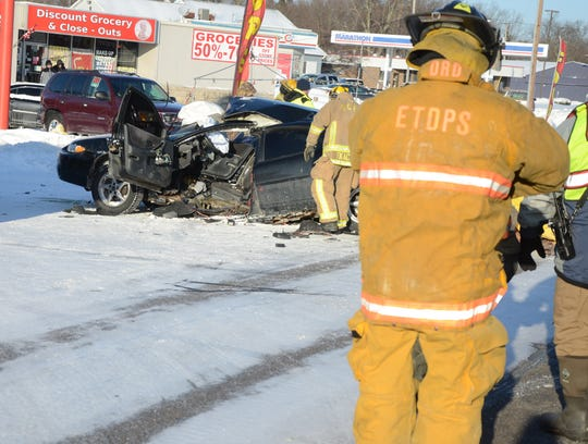 Two people died in a three-car crash Wednesday in Emmett Township.