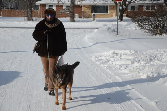 Tracy Speier and Oso were walking on Wednesday, both wearing fur to protect against the cold.