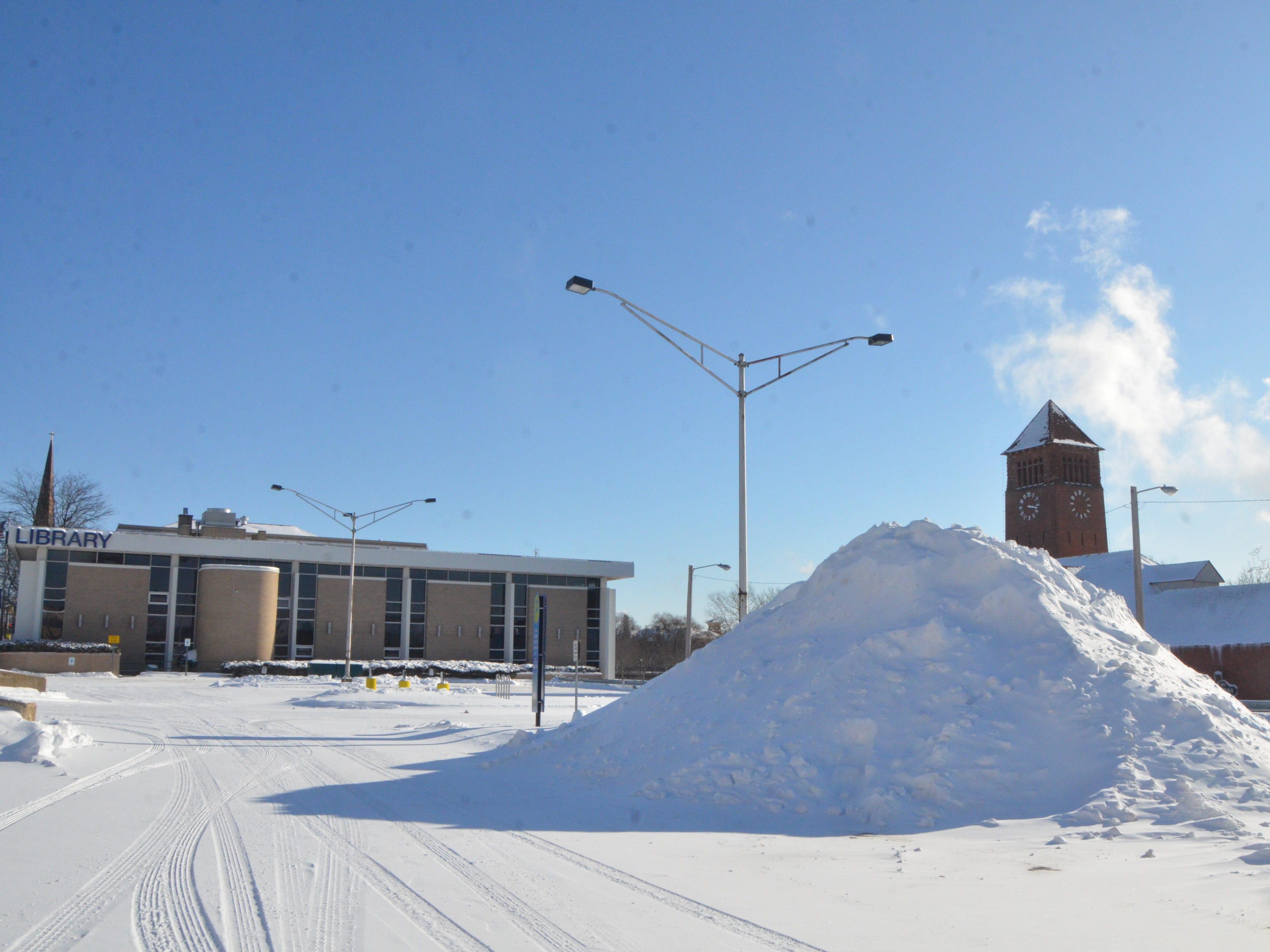A 10-foot snowbank in the Van Buren Street Parking Lot in Battle Creek on Wednesday.