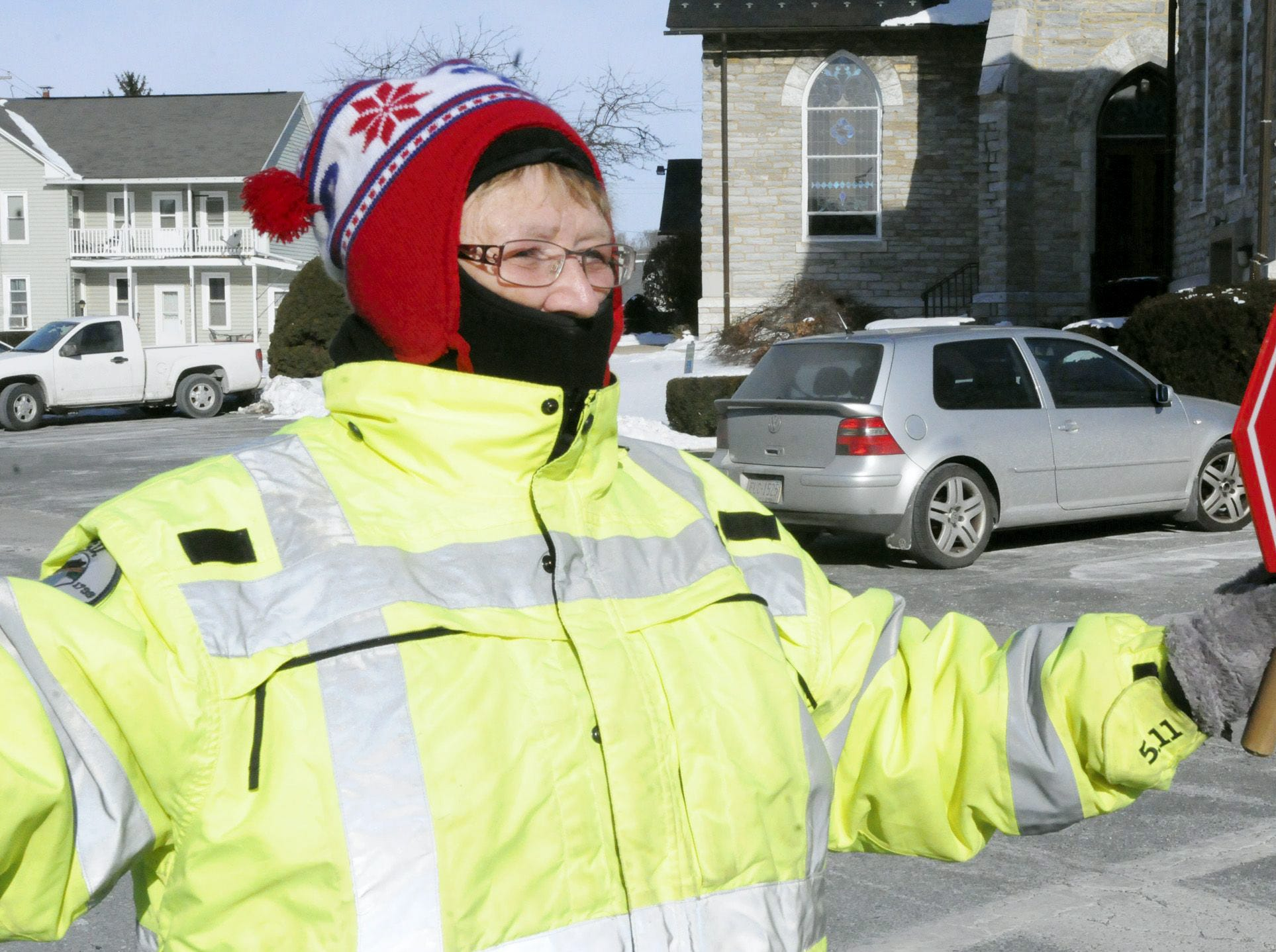 Annville Elementary crossing guard Carolyn Eisenhauer helps students cross Tuesday morning. Carolyn said she thought is was a good idea to have a 2 hour delay because of the gripping Pennsylvania. 2014.