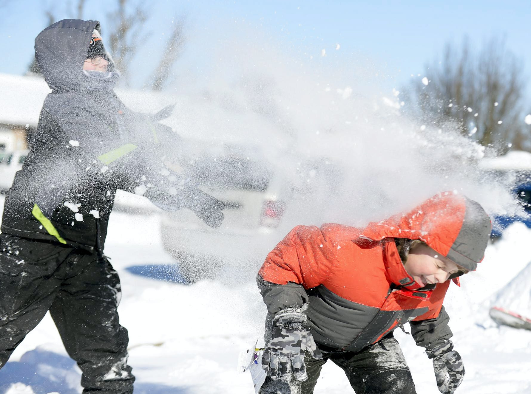 Owen Lindsay, 11, and his brother, Joshua, 8, have a snowball battle outside of their home in Cleona Borough, Pennsylvania on Friday, Jan. 3, 2014. The Lebanon Valley was hit with a snow storm Jan.2-3 and on Jan. 3 cold temps and high winds remained.