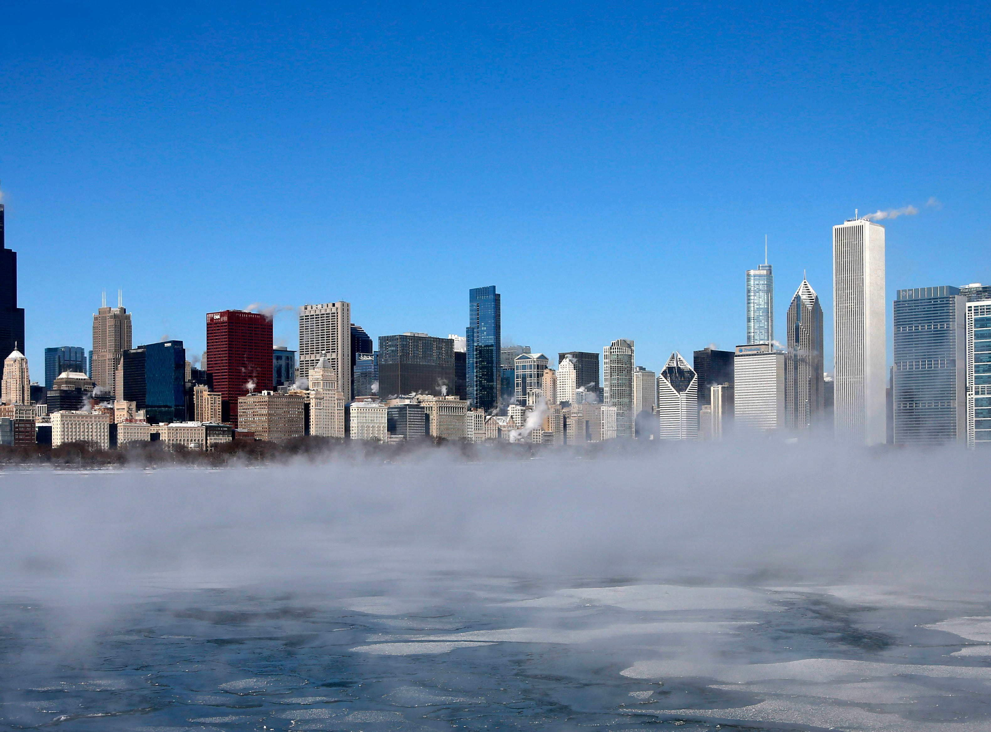 "The Chicago Skyline sits as a backdrop as fog drifts across Monroe Harbor with temperatures well below zero and wind chills expected to reach 40 to 50 below, Monday, Jan. 6, 2014, in Chicago. A whirlpool of frigid, dense air known as a ""polar vortex"" descended Monday into much of the U.S."