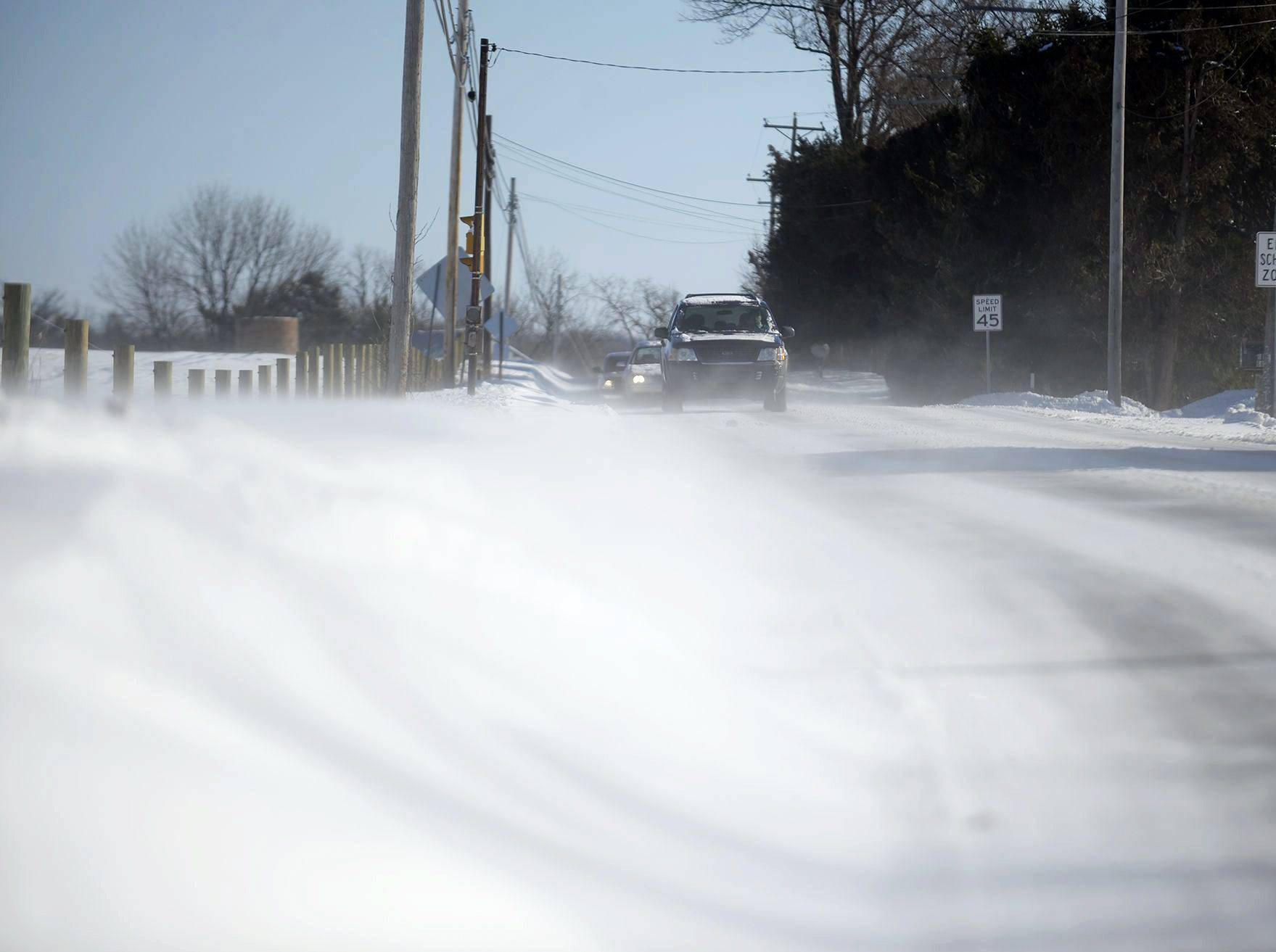 Snow drifts across Route 934 in North Annville Township  on Friday, Jan. 3, 2014. The Lebanon Valley was hit with a snow storm Jan.2-3 and on Jan. 3 cold temps and high winds remained.