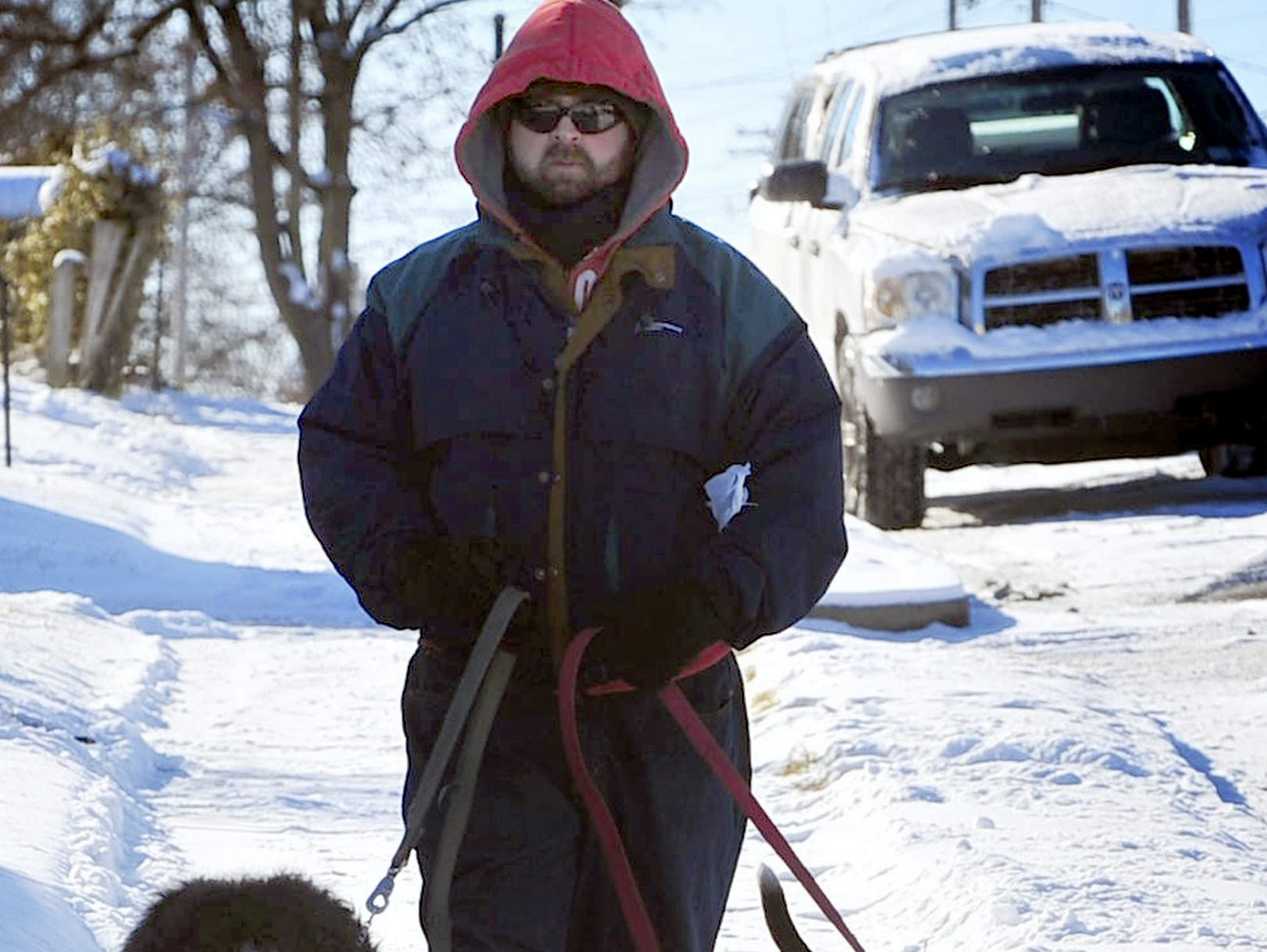Terry Martin walks his dogs Riley, left, and Moby on the coldest day of the season Friday, Jan. 3, 2014 in Chambersburg, Pennsylvania. Morning temperatures were hovered around 10 degrees.