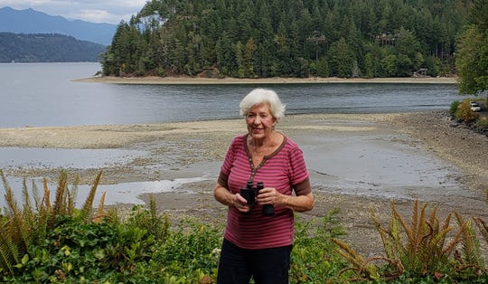 Marlene Iddings, 86, stands in front of the Reidell spit. Iddings purchased her home in front of the spit in 1959 but is now embroiled in a lawsuit with the state over ownership of the tidelands.