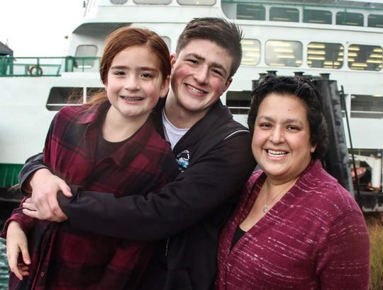 North Kitsap swimmer Nathan Ramey poses for a family photo with his sister Natalie (left) and mother Adrianne. The Ramey family doing its best to stay busy as Adrianne battles stage 4 breast cancer.