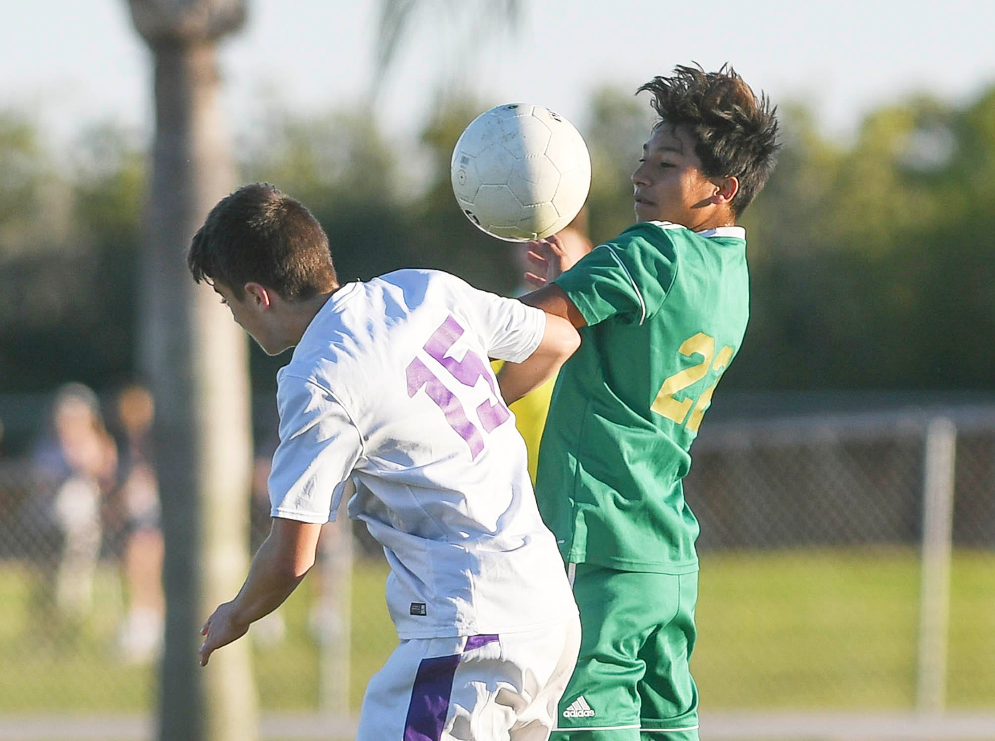 Lukas Photiou of Space Coast and Junior Acuna of MCC vie for a header during Tuesday's District 8, Class 2A semifinal at Cocoa Beach High.