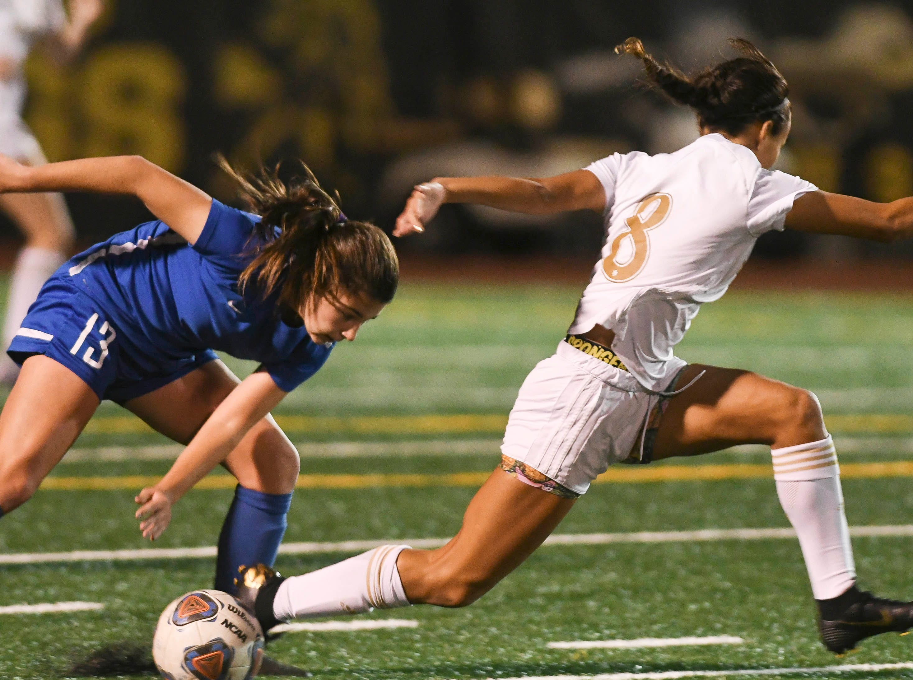 Titusville's Raelyn Prince (13) and JoJo Michaels of Merritt Island trip over each other during Tuesday's District 12, Class 3A soccer semifinal.