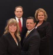 The Carter Hester Group: (clockwise from bottom left) Faith Wheeler, service associate; Tim Hester, financial advisor; Terri Dingman, registered associate; Joe Carter, financial advisor