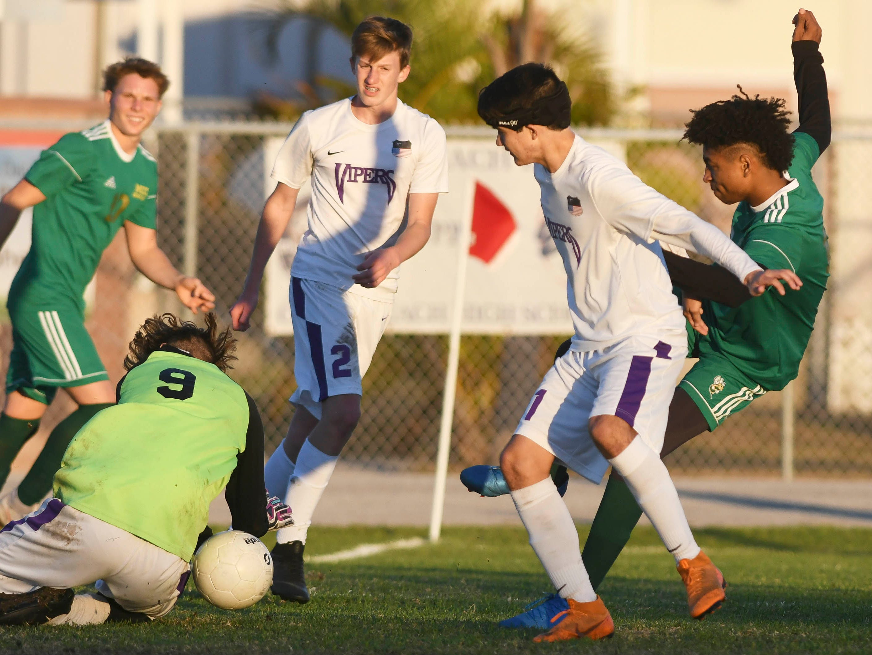 Space Coast goalkeeper Alexander Poole stops a shot by Issac Begin of Melbourne Central Catholic during Tuesday's District 8, Class 2A semifinal at Cocoa Beach High.