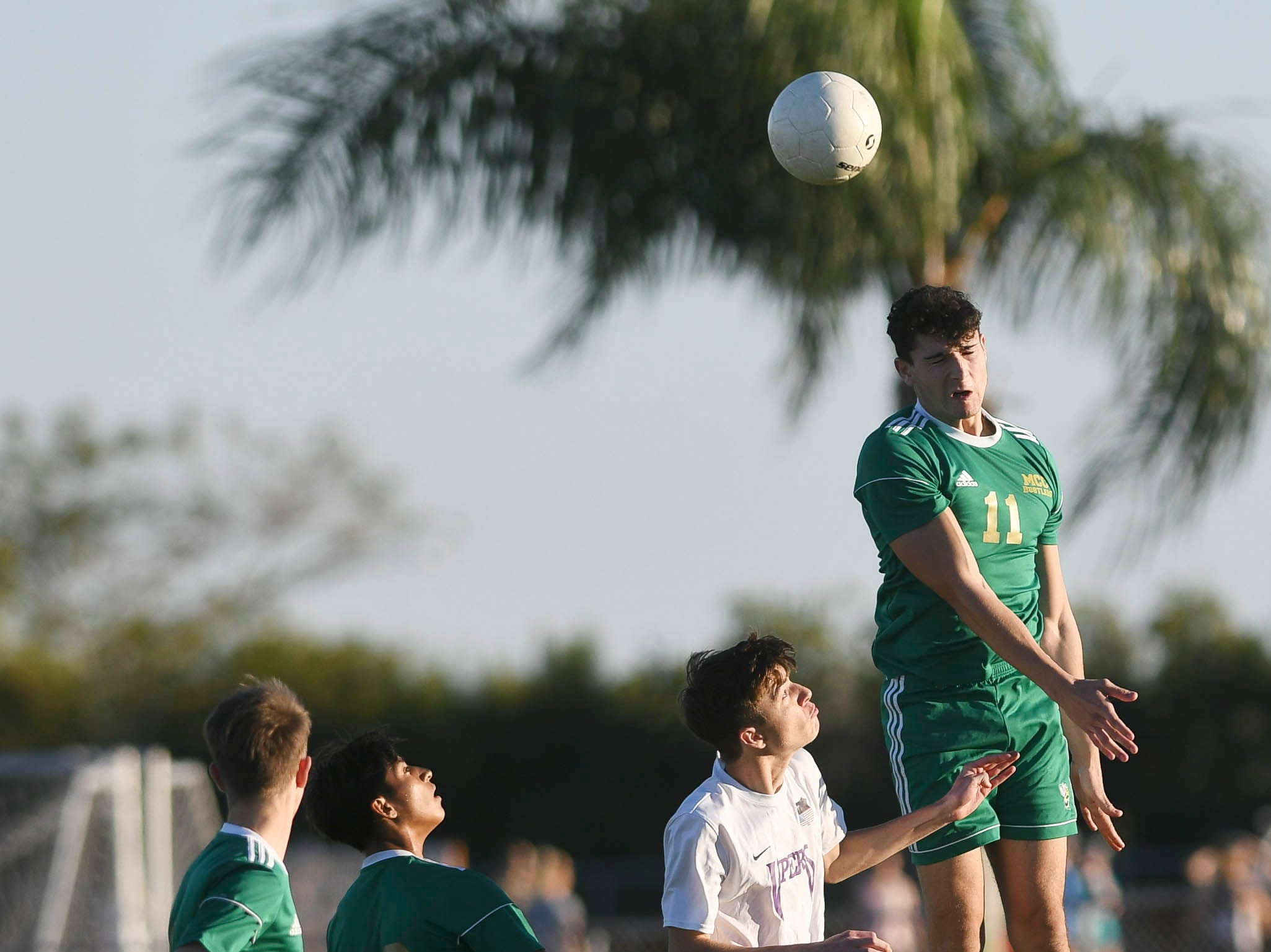 MCC's Kyle McBride heads the ball during Tuesday's District 8, Class 2A semifinal against Space Coast.