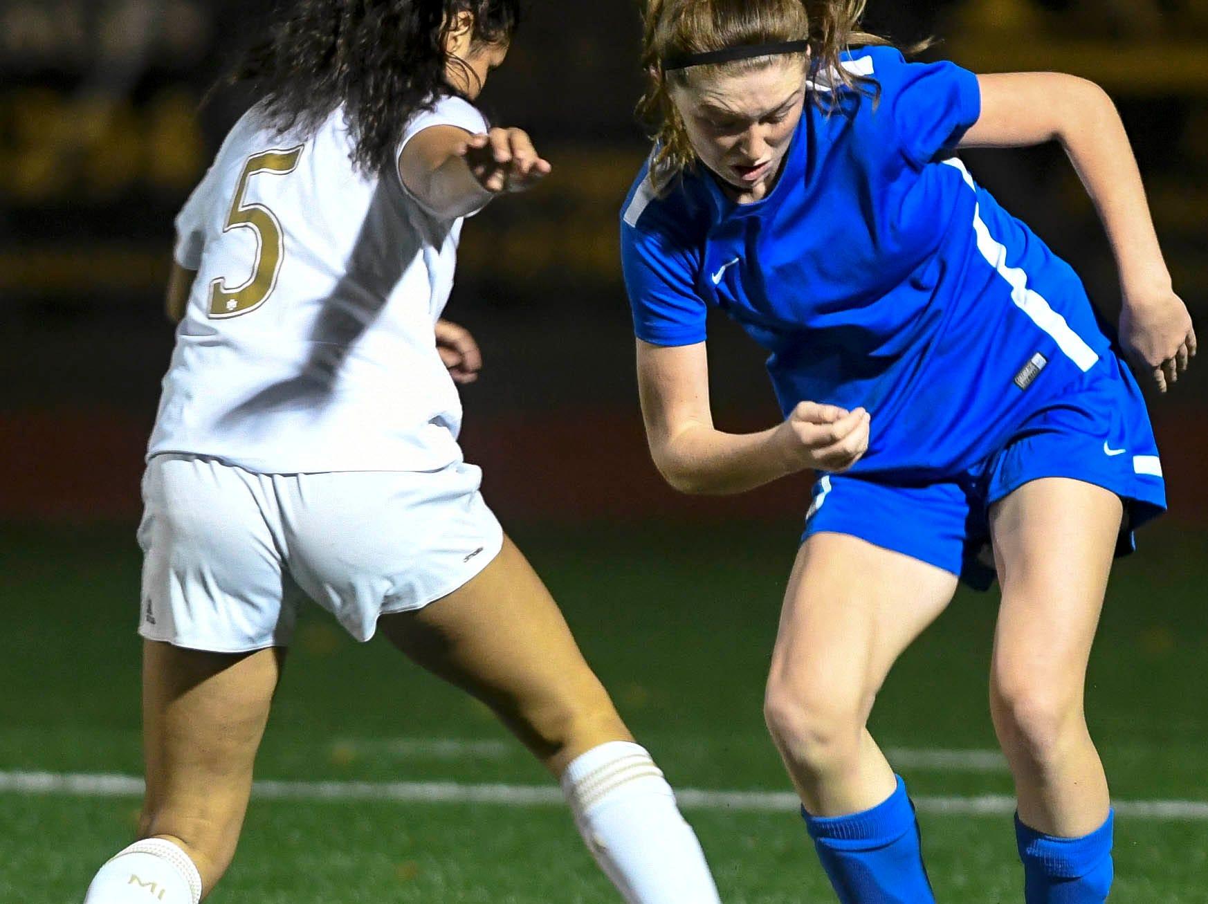 Titusville's Sarah Duschesneau redirects the ball away from Merritt Island's Amaya Quintal during Tuesday's District 12, Class 3A soccer semifinal.