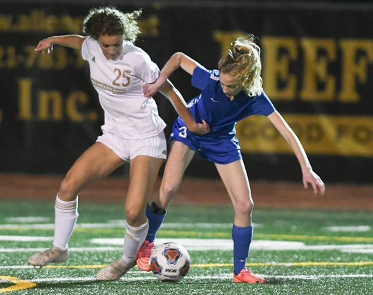 Jessica Martin of Merritt Island fights for the ball with Bailey Gilmore during with  District 12, Class 3A semifinal at Merritt Island High.