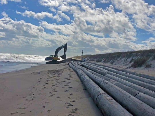 Pipe is being positioned on Indian River County beaches just south of Sebastian Inlet to carry sand dredged from the inlet's sand trap for the Sebastian Inlet District's ongoing dredging and beach renourishment project.