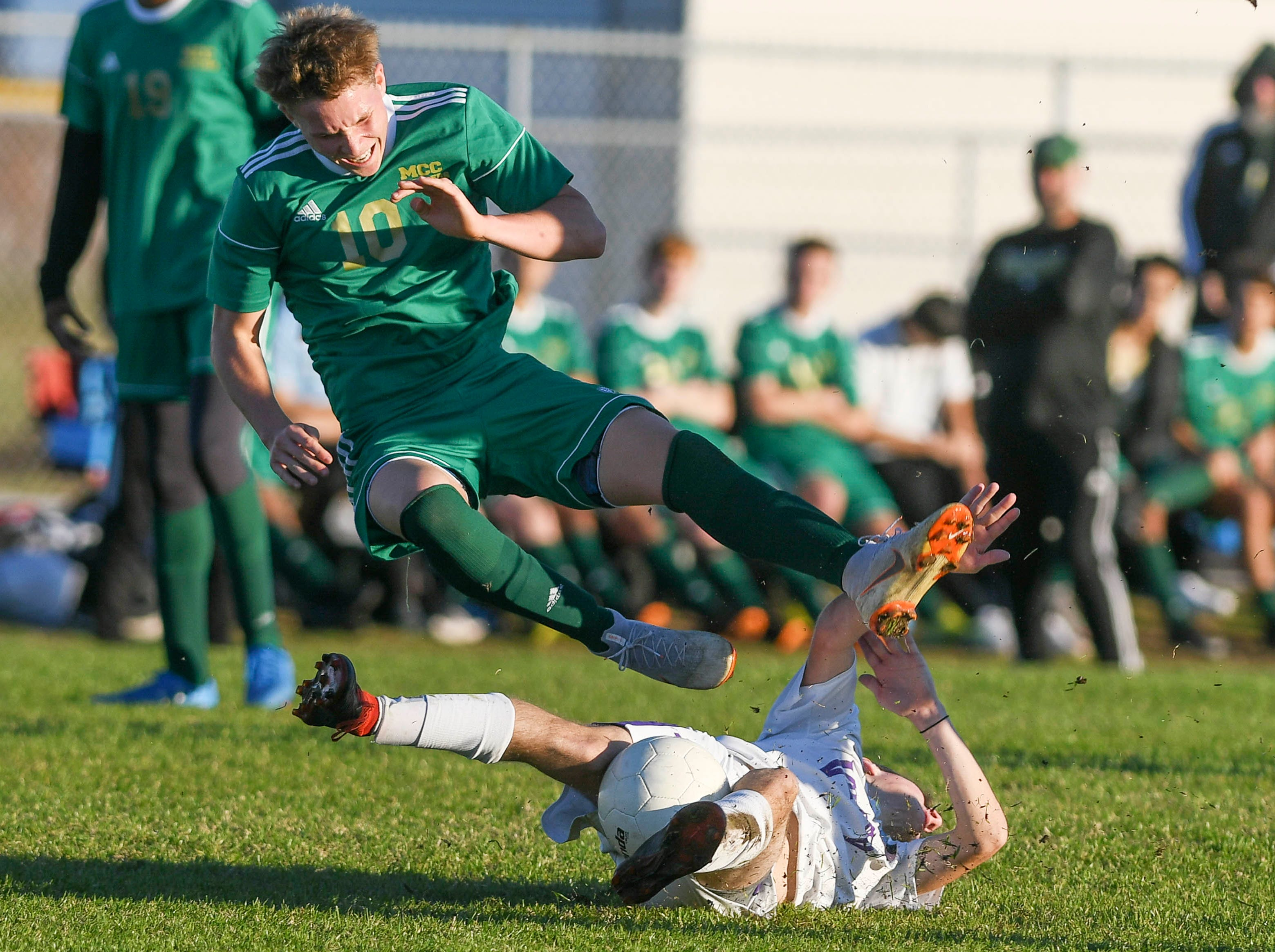 Mark Alcorn of Melbourne Central Catholic is upended by Christian Powell of Space Coast during Tuesday's District 8, Class 2A semifinal at Cocoa Beach High.