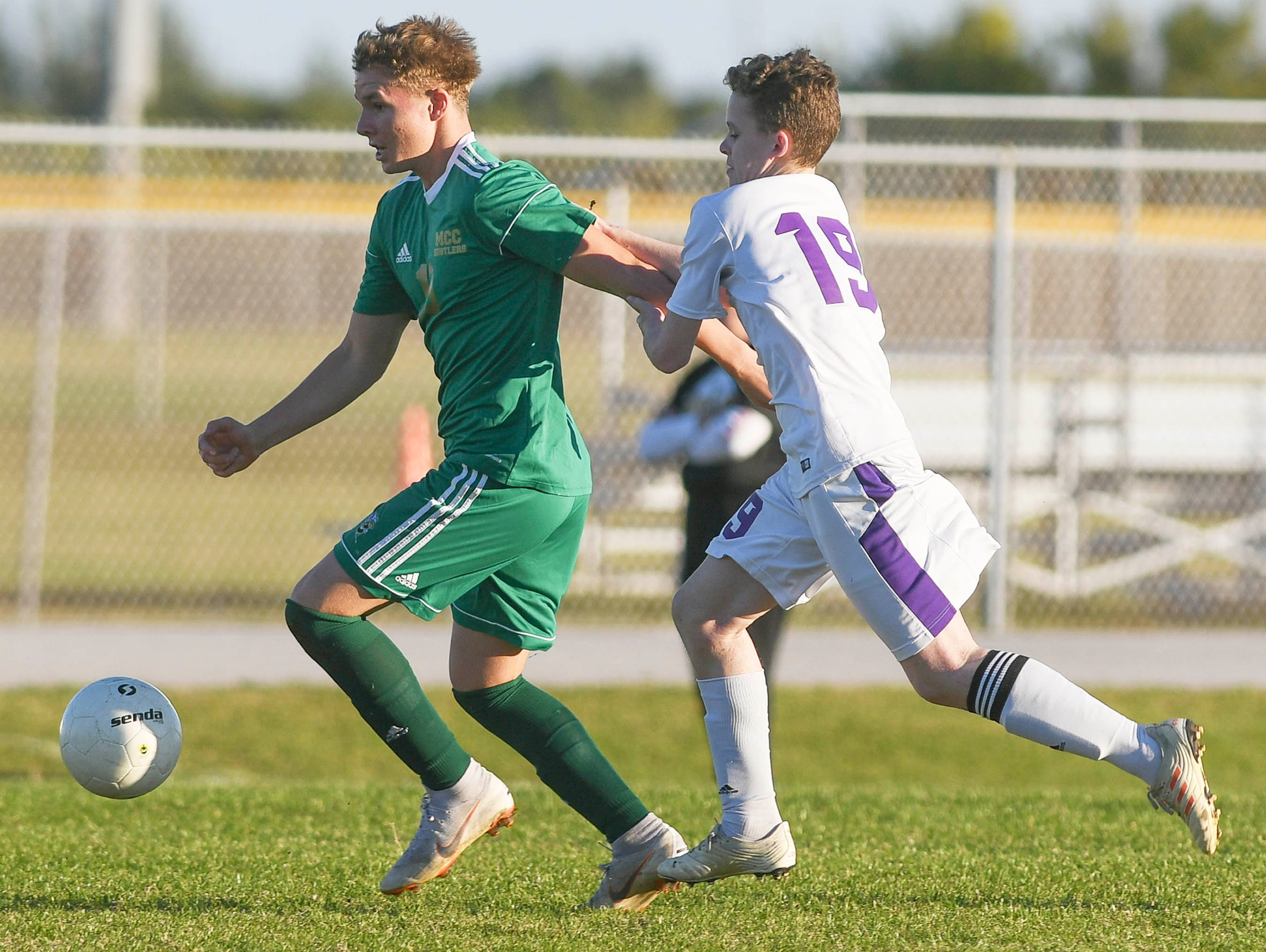 Mark Alcorn of Melbourne Central Catholic is chased by Colby Karpowich of Space Coast during Tuesday's District 8, Class 2A semifinal at Cocoa Beach High.