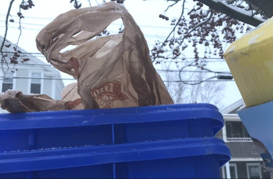 "A plastic supermarket bag is among the items left out for ""blue-bin"" recycling on Maple Street in Burlington on Wednesday, Jan. 30, 2019."