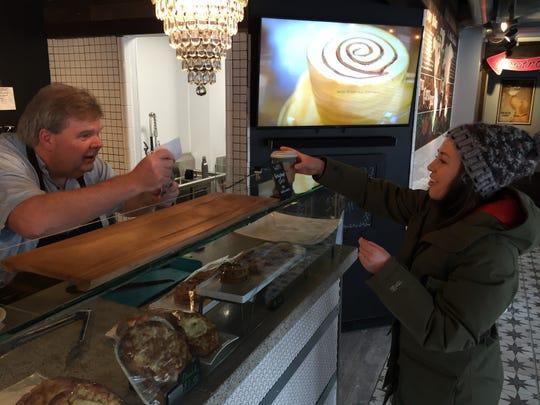 Perky Planet Coffee Shop owner Richard  Vaughn waits on Kelsey Tierney of Monkton on Jan. 29, 2019.