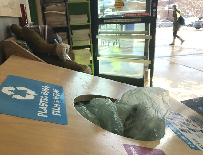 A bin for recycling thin plastic shopping bags sits near the entrance to City Market in Burlington on Wednesday, Jan. 30, 2019.