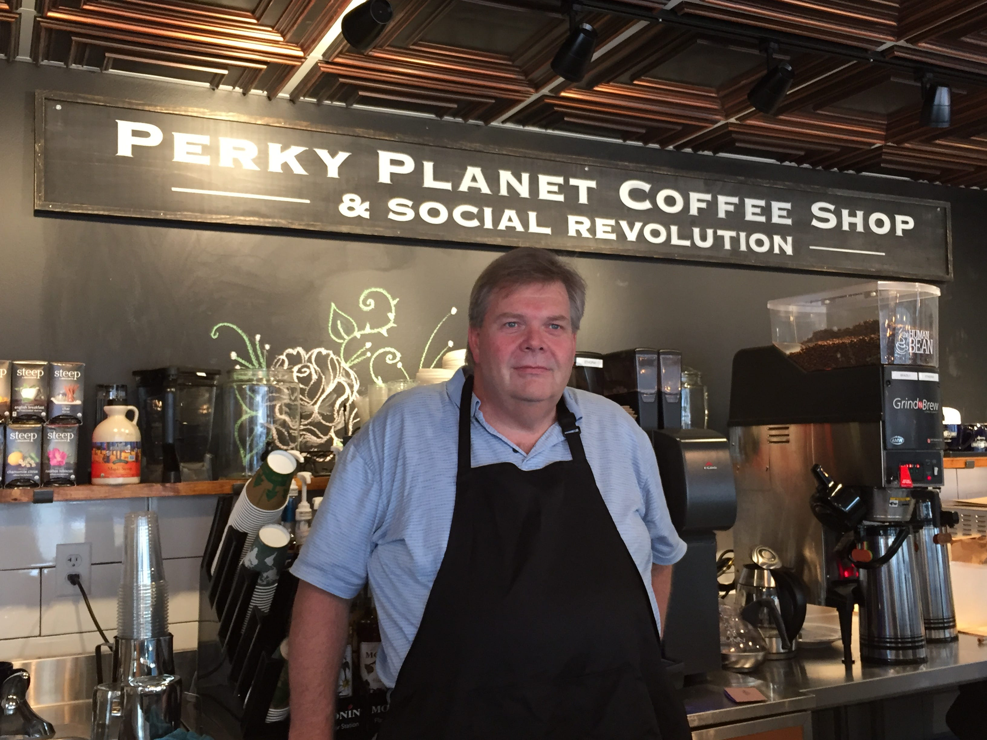 Owner Richard Vaughn stands in his new coffee shop, Perky Planet, on St. Paul Street in Burlington in late January 2019.