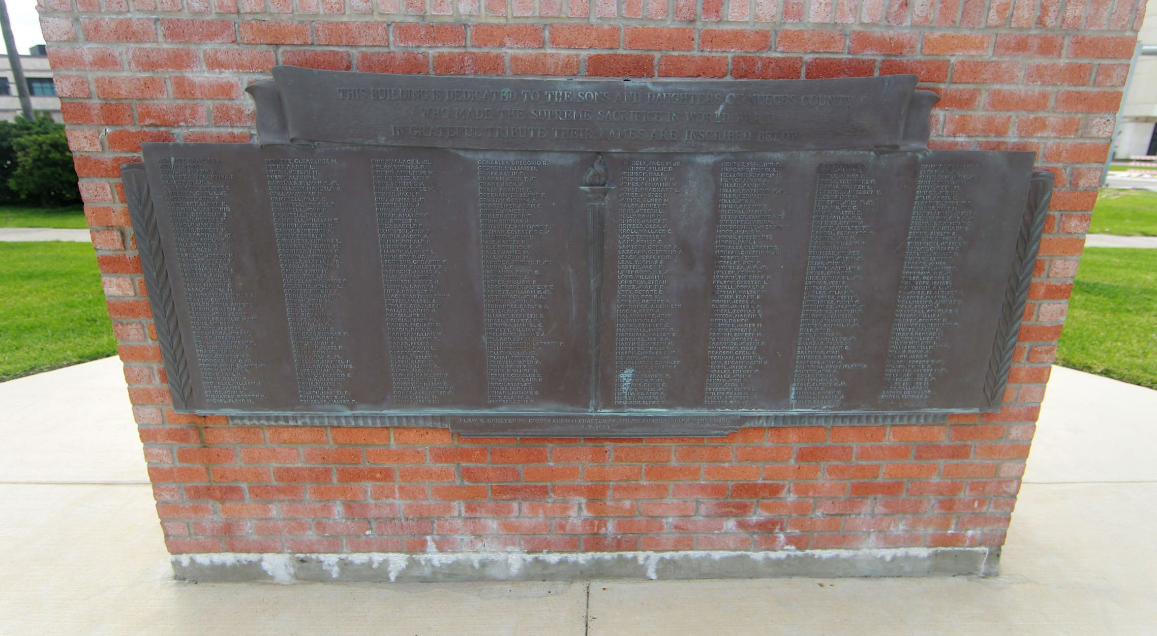 The memorial dedicated to the Nueces County service members killed in World War II was originally mounted on the Memorial Coliseum. The plaque is now in Sherrill Park and mounted on bricks salvaged from the coliseum.
