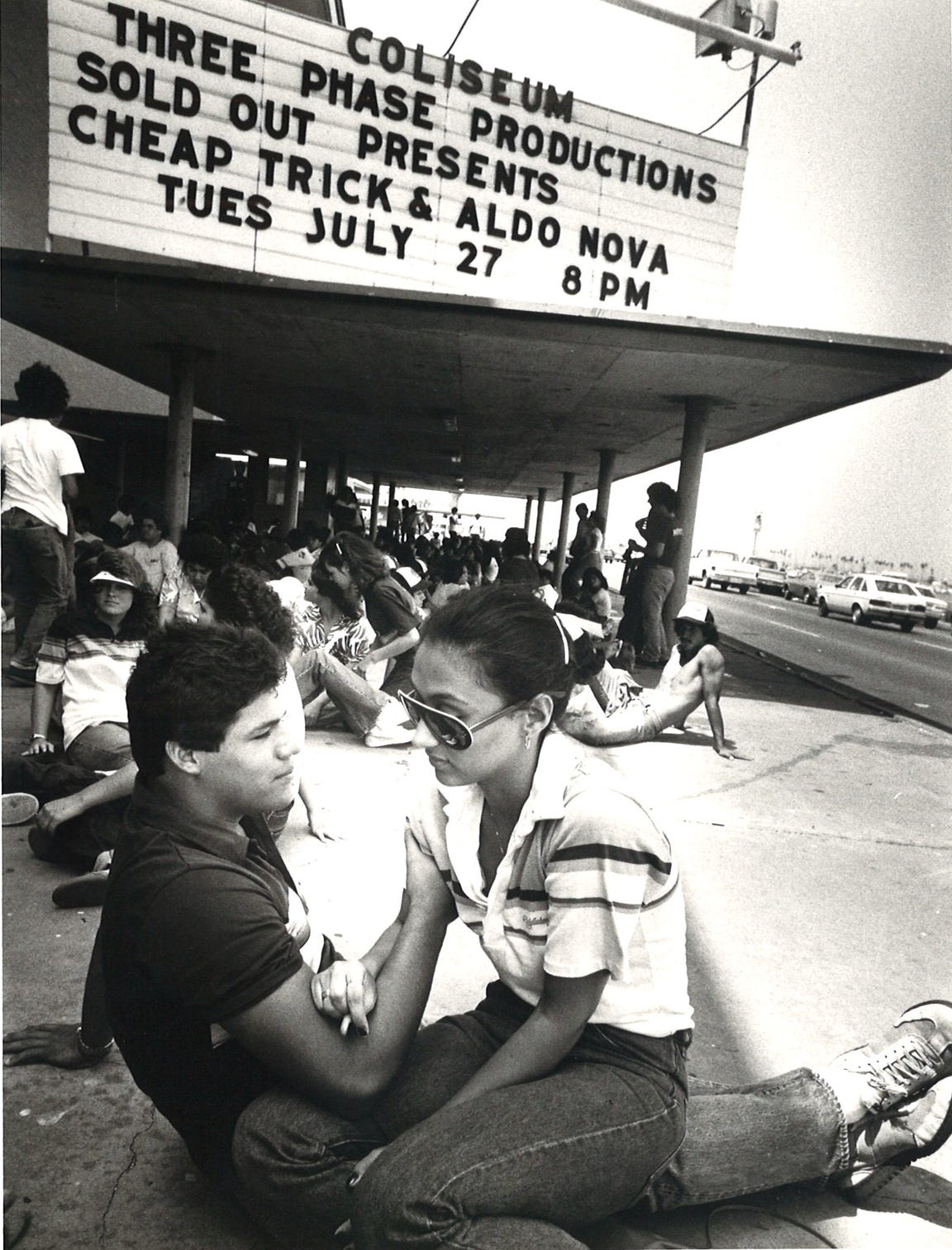 Veronica Garza, 17, and boyfriend Richard Perez, 17, wait in line in front of Memorial Coliseum in Corpus Christi on July 27, 1982 for the Cheap Trick and Aldo Nova concert.