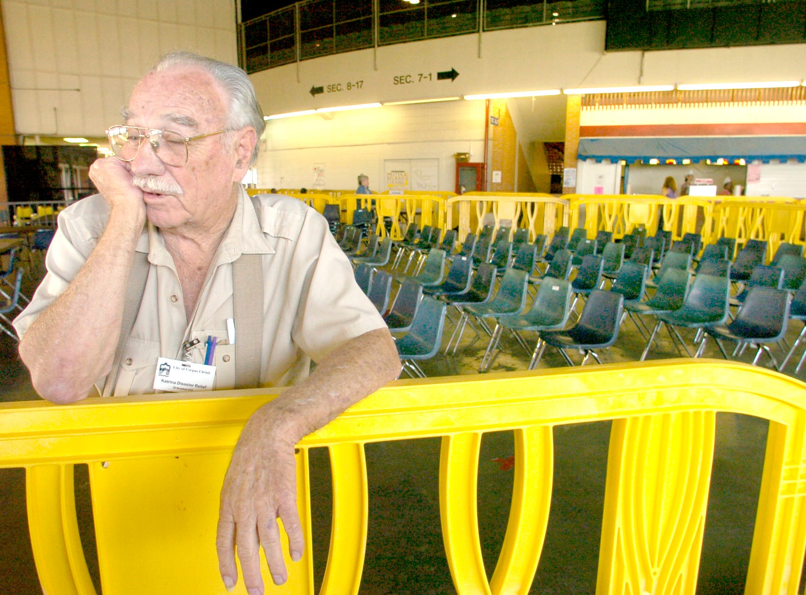 Merlin Soler, 83, evacuee from New Orleans, relaxes at Memorial Coliseum Sept. 19, 2005 as he keeps a eye on a near by televisions set broadcasting the latest new of Tropical Storm Rita. Evacuees were temporarily housed in the coliseum, which had closed to public events in 2004.