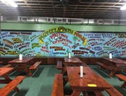 A 75-foot mural in MG's Pizza in Robstown has nearly every high school within 50 miles of Corpus Christi on it. Patrons show their school spirit by taking pictures.