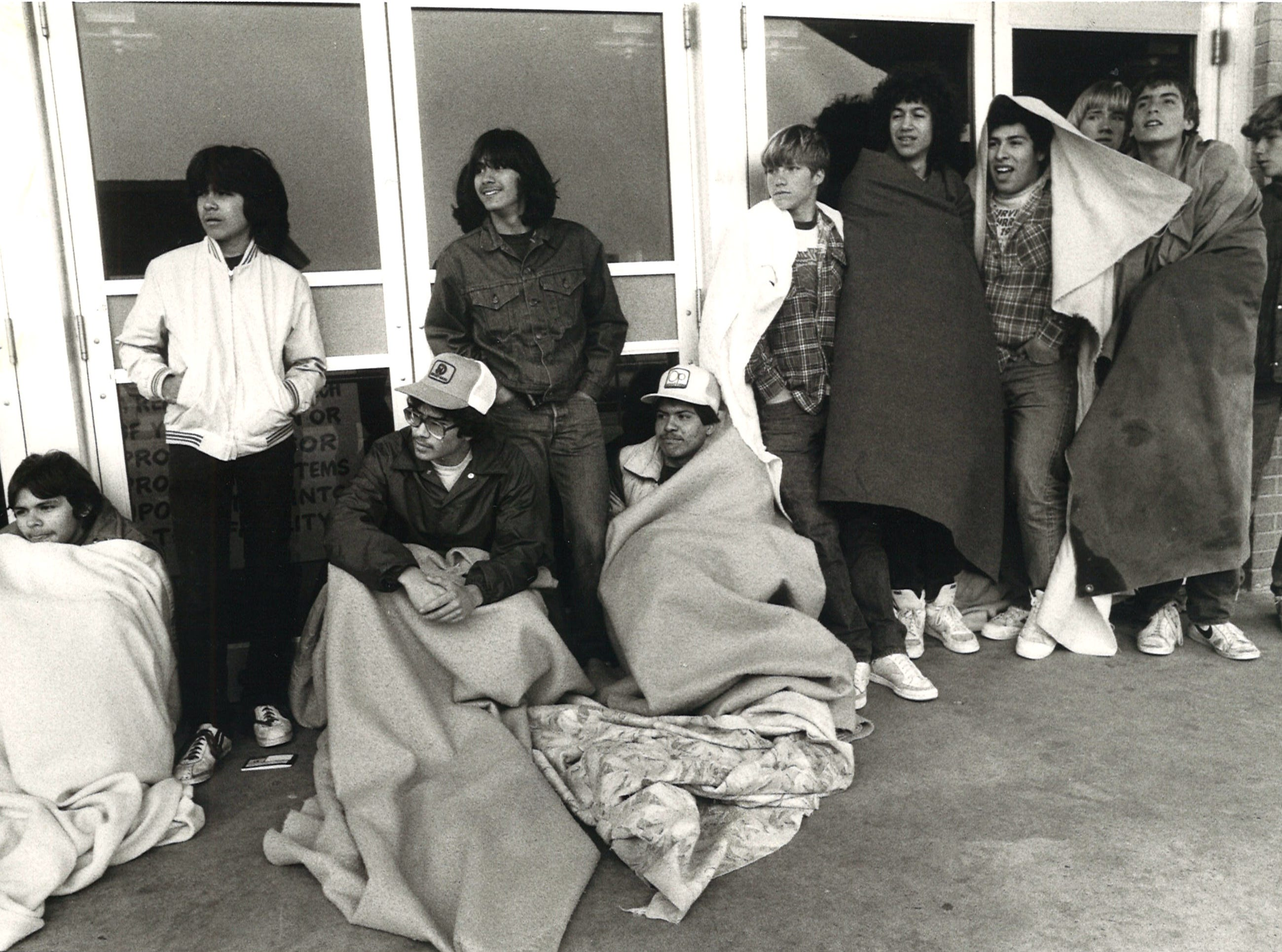 Teens and young adults line up in the rain and cold to be first in line to buy tickets to see Sammy Hagar and Night Ranger at Memorial Coliseum in Corpus Christi on Feb. 26, 1983.