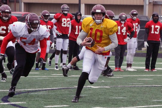 San Antonio Commanders quarterback Dustin Vaughan, a Calallen graduate, runs during a training camp practice on January 15, 2019 in San Antonio.