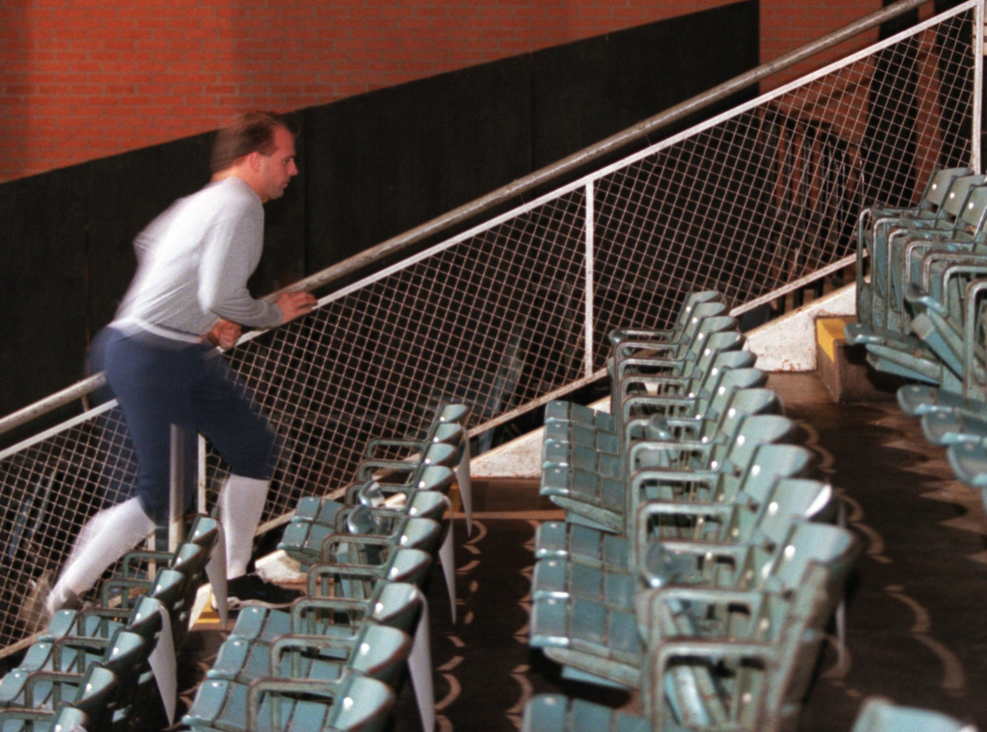 Iceray head coach Taylor Hall runs up the stairs at the Memorial Coliseum in February 2000. The IceRays used to play in the coliseum before moving to the American Bank Center in 2004.