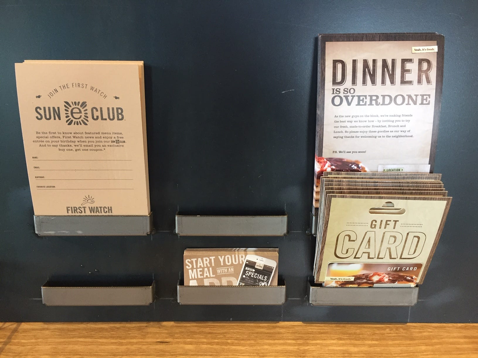 Gift cards and First Watch Sun Club membership club info are offered at the hostess station.