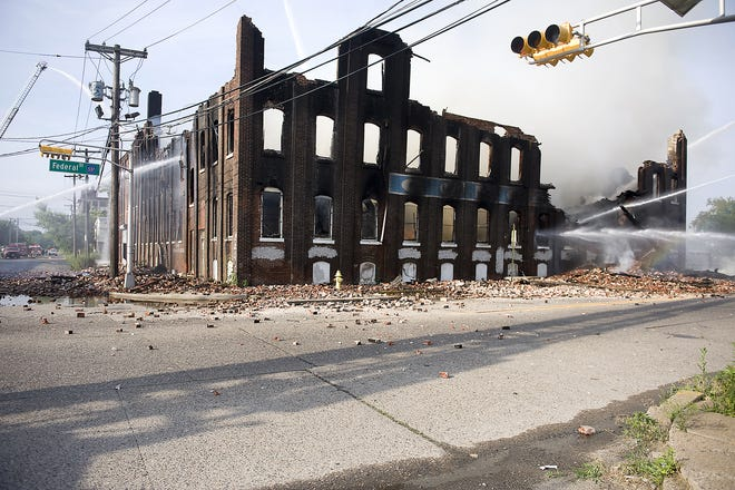 Firefighters  work to control a multi-alarm blaze at the former Concord Chemical Company at 17th and Federal Streets in Camden on Sunday morning, June 19, 2011.
