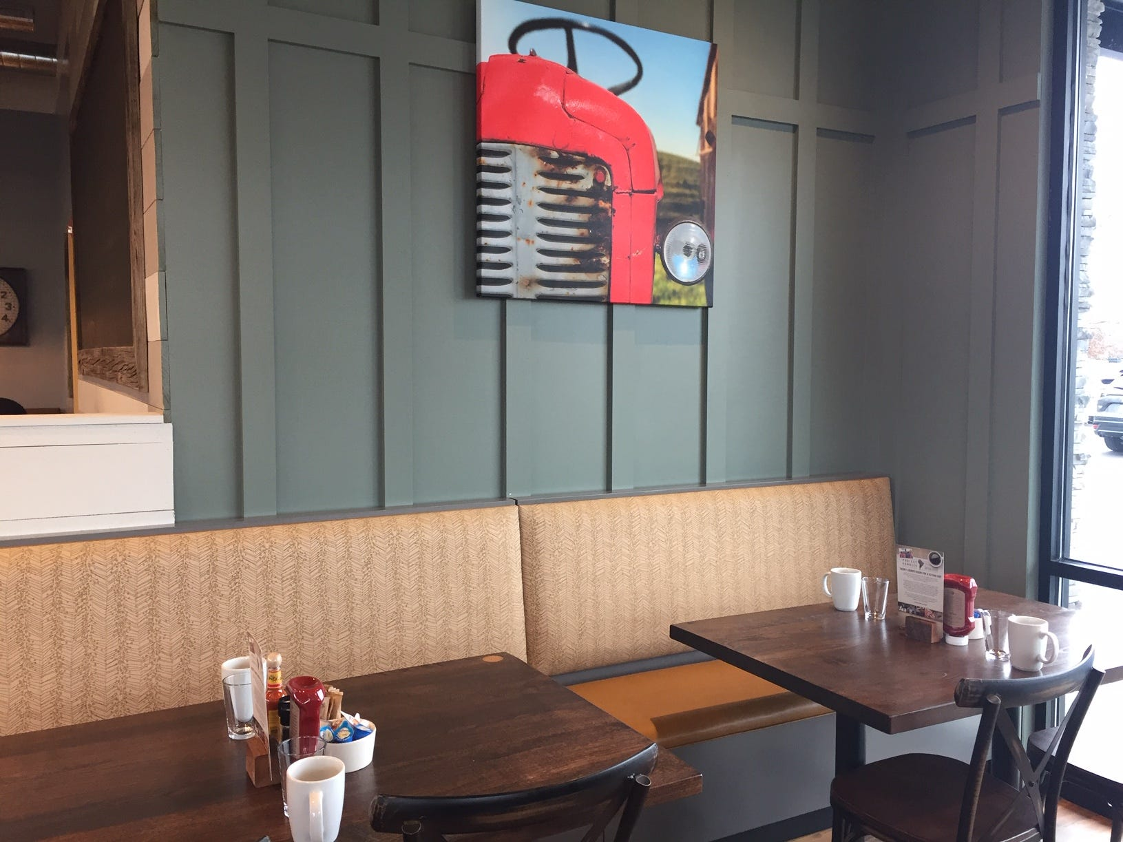 Individual tables share banquette seating at First Watch in Cherry Hill.