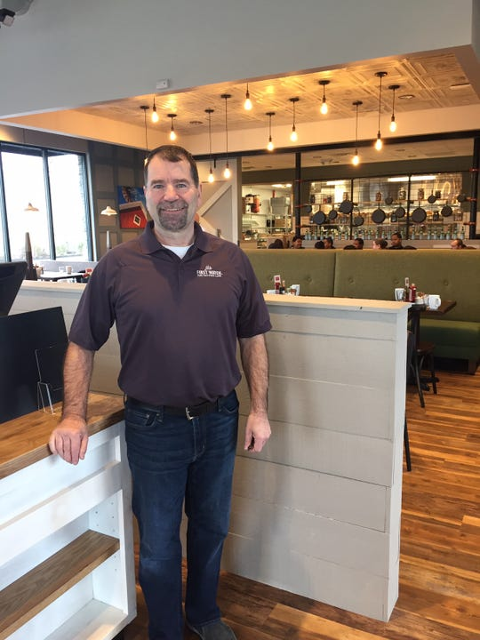 First Watch Cherry Hill's General Manager Mike Skidmore stands near the hostess station of the Cherry Hill restaurant, the first in the state.