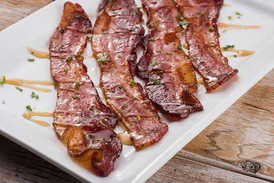 Million Dollar Bacon is on the First Watch seasonal menu. Four slices of our signature hardwood smoked bacon baked with brown sugar, black pepper, cayenne and a maple syrup drizzle.