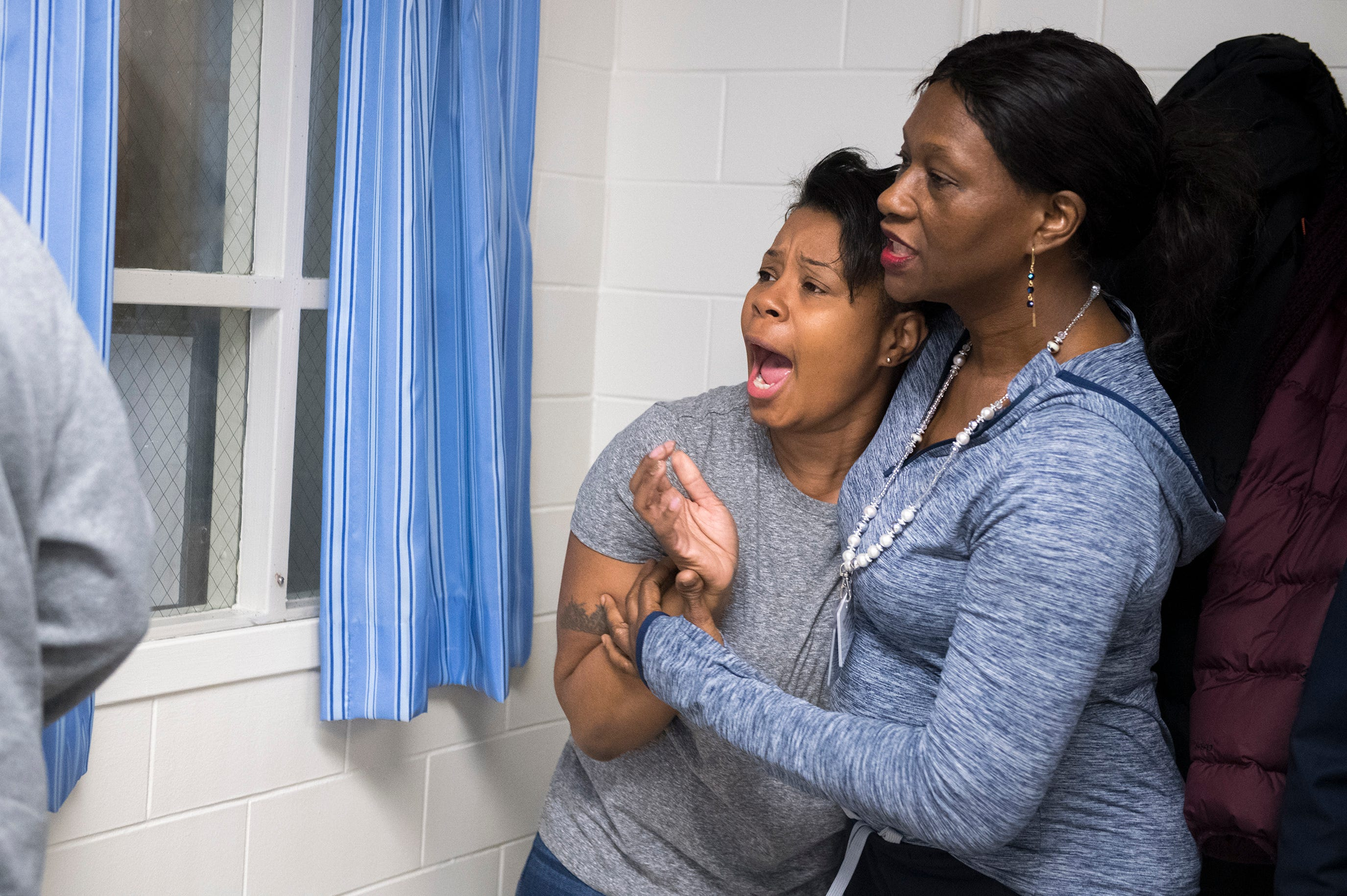 Human service techs Sarah Huntley, left, and Christine Mason act out a training simulation at Ancora Psychiatric Hospital in Winslow Township, N.J.