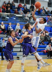 Jayvon Maughmer jumps to score two of his twenty points Tuesday night against Logan at Chillicothe School.