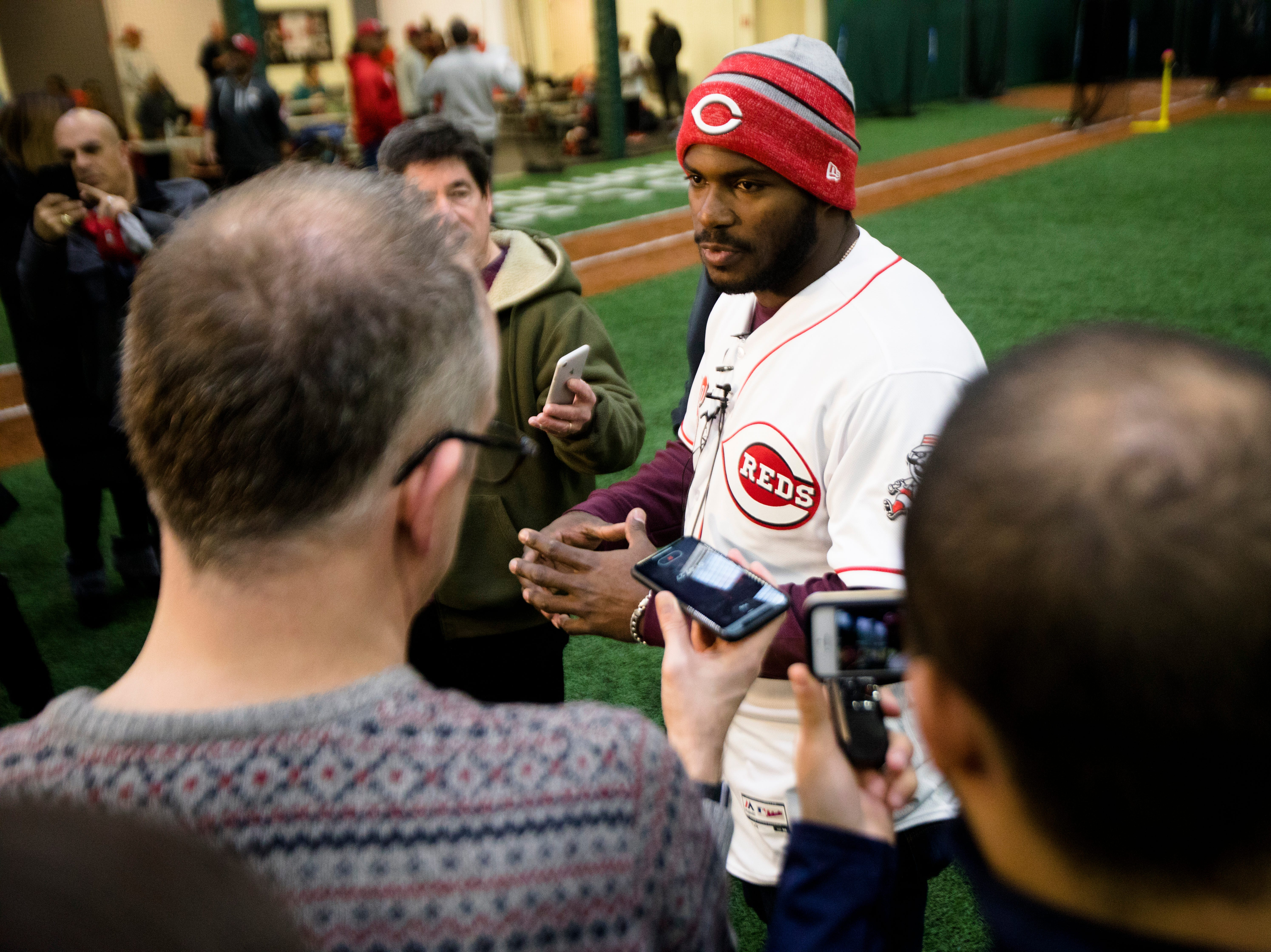 Yasiel Puig, who has been traded to the Cincinnati Reds from the LA Dodgers, speaks to members of the media at the P&G MLB Cincinnati Reds Youth Academy on Wednesday, Jan. 30, 2019.