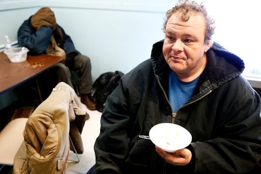 Joshua Burns, 34, eats breakfast at the Emergency Shelter of Northern Kentucky in Covington Wednesday, January 30, 2019. Emergency cold shelters have opened across the Greater Cincinnati as the wind chill has reached 20 below zero in parts of the area.