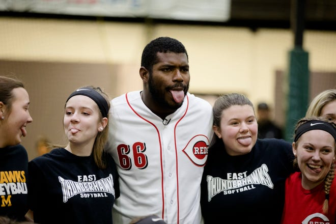 Yasiel Puig, who was traded to the Cincinnati Reds from the LA Dodgers, poses with young athletes at the P&G MLB Cincinnati Reds Youth Academy on Wednesday, Jan. 30, 2019.