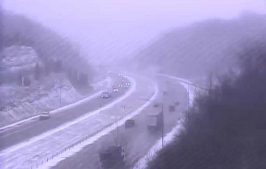 Snow is reducing visibility along I-275 in Kentucky Wednesday.