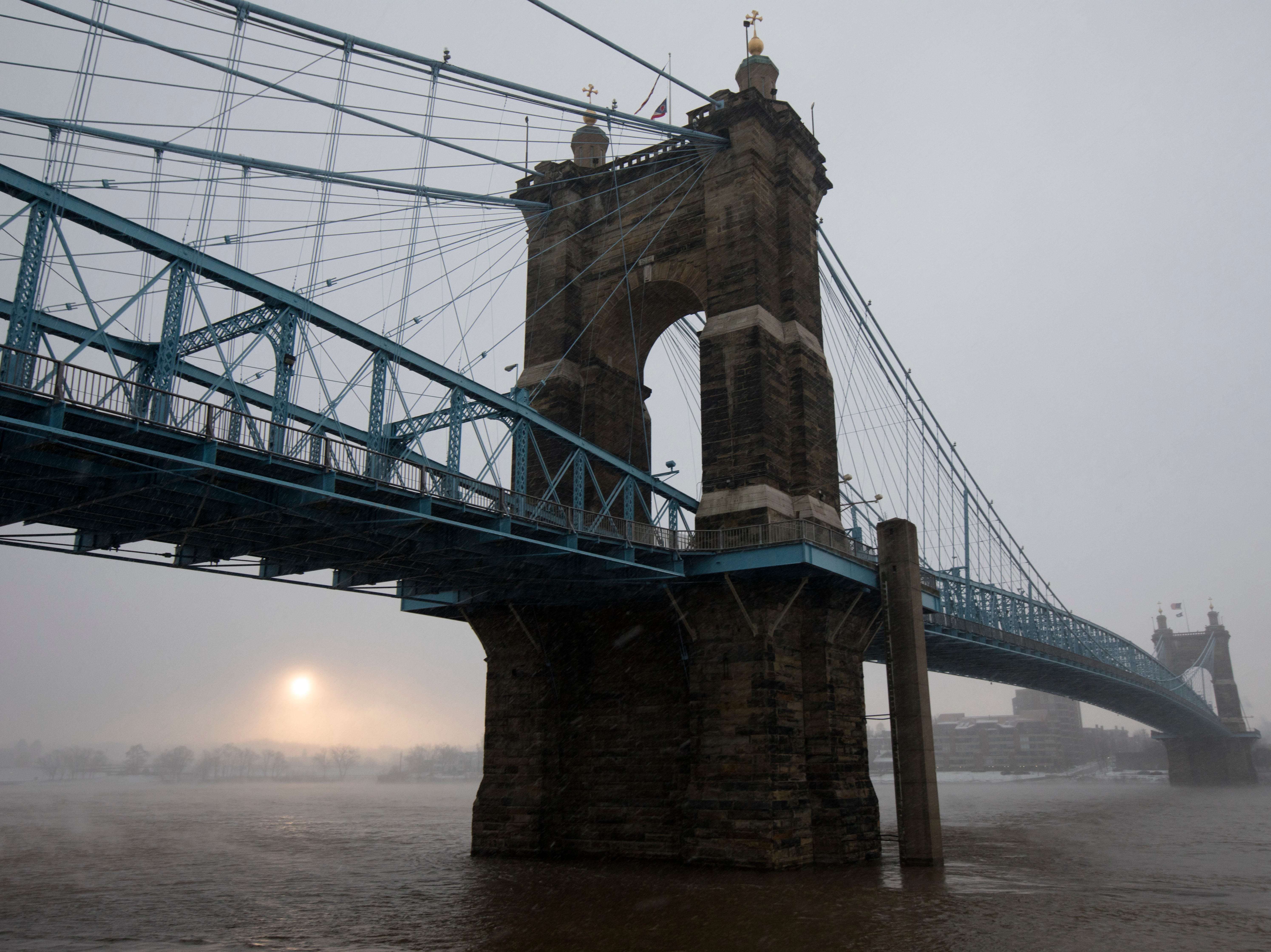 A view of the Roebling Bridge during a winter storm on Wednesday, Jan. 30, 2019, in Downtown Cincinnati. The extreme cold and record-breaking temperatures are moving through Ohio from a storm that pounded Missouri earlier this week. The National Weather Service has issued a wind chill advisory for the Cincinnati Area. The wind chill is currently -17 degrees Fahrenheit.