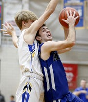 Reading guard Brandon Ross is prevented from scoring by Madeira guard Grant Breit during their game at Madeira Tuesday, Jan. 29, 2019.