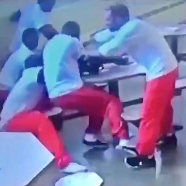 'Just let them die': Guards laughed as supremacist stabbed cuffed black inmates, suit says