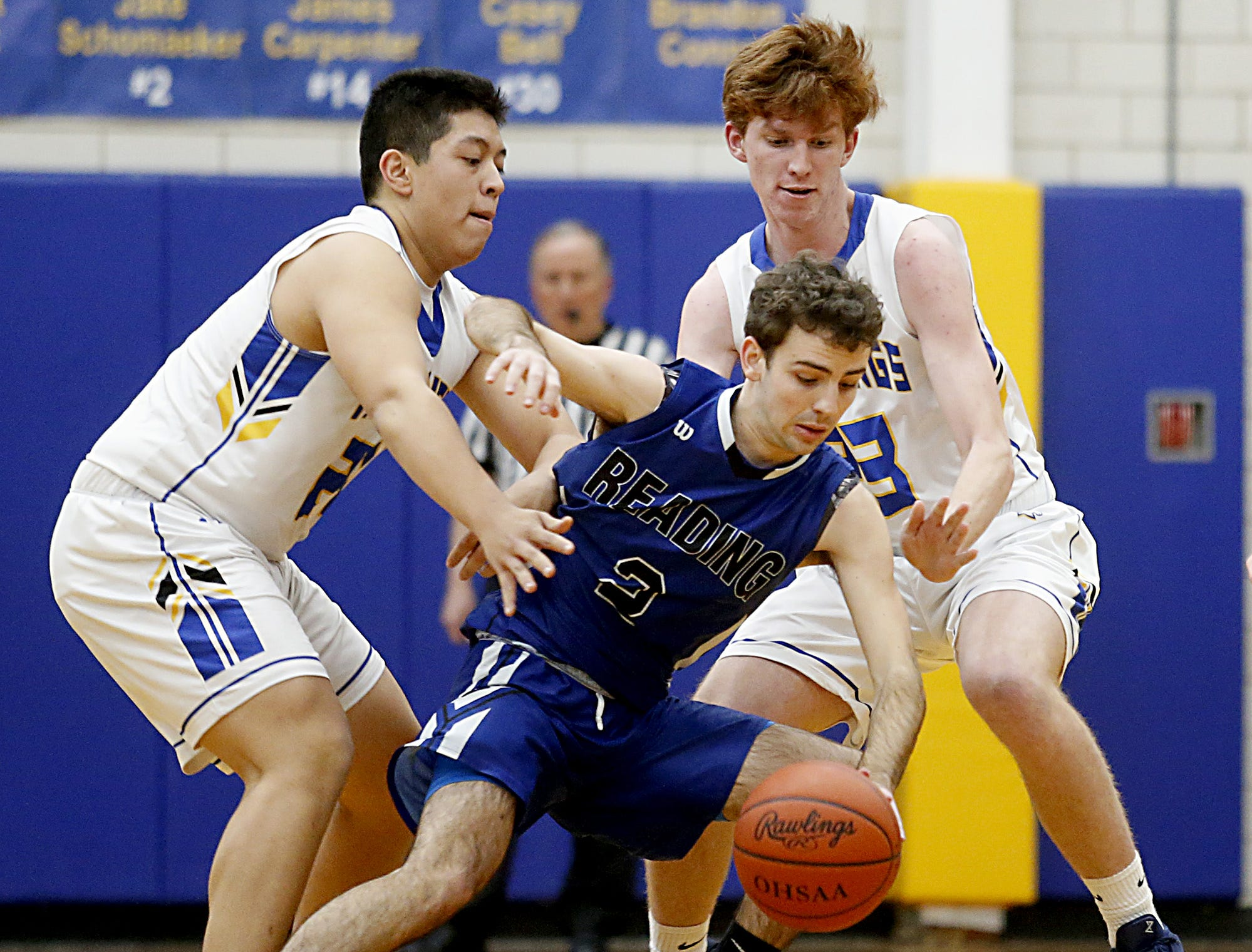 Reading guard Brandon Ross is double teamed by Madeira forward Steven Noung and guard Sam Solinski during their game at Madeira Tuesday, Jan. 29, 2019.