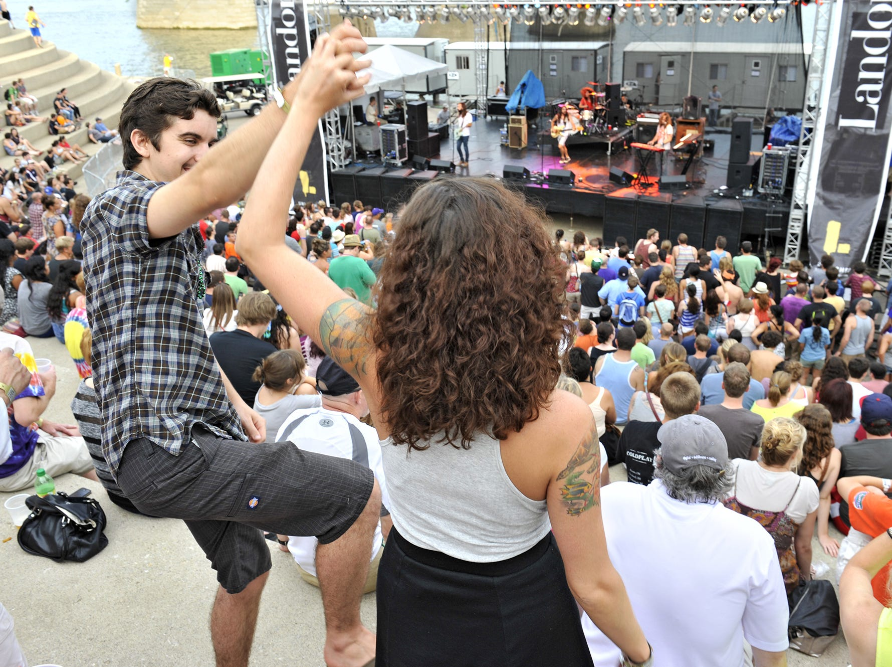 Josh Chal and Ashley Goodridge dance to Bright Light Social Hour at last year?s festival. Promoters expect bigger crowds this year. David Sorcher / File Enquirer file METROMIX JULY 13, 2012 - BUNBURY MUSIC FEST - Saturday's scattered showers did little to deter the fun at the second day of the Bunbury Music Festival, a three day festival featuring over 100 band and DJs on five different stages spread along the Ohio River at Sawyer's Point and Yeatsman Cove. Josh Chal and Ashley Goodridge dance to The Bright Light Social Hour at the Landor Stage.