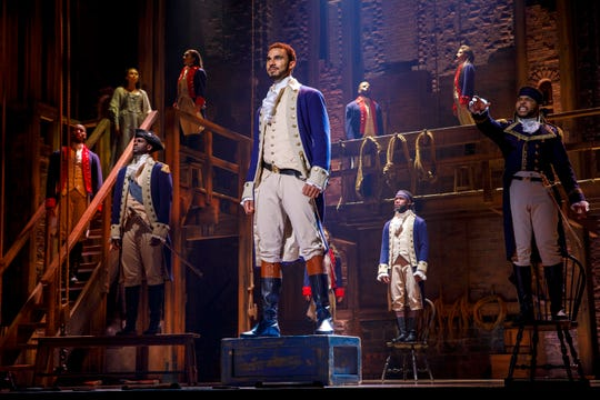 """Austin Scott (center), as Alexander Hamilton, with the cast of the National Tour of """"Hamilton: An American Musical."""" The blockbuster musical rolls into Aronoff Center as part of the Broadway in Cincinnati series on Feb. 19 and runs through March 10."""