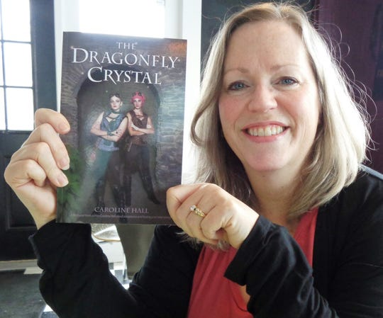 """Loveland author Caroline Hall with  her first book release """"The Dragonfly Crystal"""" targets proceeds to benefit The Dragonfly Foundation and The Cure Starts Now."""