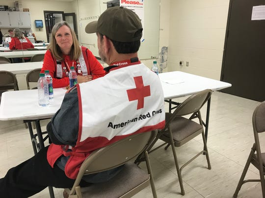 Registered nurses Pam Turner and Jim Shaw , who volunteer for the Red Cross, talk at an emergency shelter set up for victims of a fire at Ashford Place Apartments on Tuesday, Jan. 29, 2019.